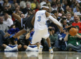 (DLM9171) -  Denver Nuggets guard Allen Iverson swipes the ball away from Orlando Magic guard...