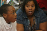 Teacher Terri Roston (cq),right, works with student, Abel Mims (cq), 13, on a school project,...