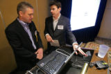 Todd Vernon (cq, left), CEO of Ligit Networks in Louisville, gets a few pointers on time...