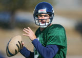 The Colorado Crush's John Dutton (#8, QB) looks to pass during practice for the 2007 season at...