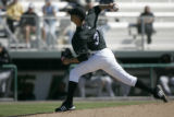 Colorado Rockies pitcher Ubaldo Jimenez pitches in his debut against the Chicago White Sox in the...