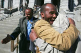 Cab drivers (all cq) Kelil Barasso, left, celebrates as  Ahmed Shafi, center, hugs Saidl Adam...