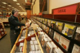 [JPM561] Barnes & Noble in Glendale, Colo., music manager Jan Colombo (cq) demonstrates use of...