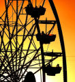 The ferris wheel at Six Flags Elitch Gardens at sunset