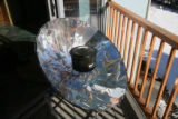 A solar stove sits on the deck, Thursday afternoon, February 15, 2007 at her house in Golden. The...