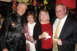 (left to right) Terry Reitan and his wife, decorations co-chair, Pam Reitan, enjoy the silent...