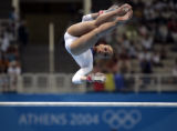 (ATHENS, GREECE, AUGUST 17, 2004)  USA gymnist Terin Humphrey works on the uneven bars during the...