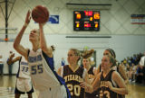 (from left) Broomfield's Anna Prins wins the ball from Windsor's Erin Wilkinson and Alex Neely as...