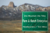A bullet-riddled sign for the Farm & Ranch Enterprise at the Ute Mountain Ute Triibe...