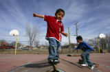 Seth Lopez (cq), 4, balances while playing on a make-shift ramp for skateboarders while in...