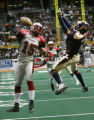 Rampage Chuck Wesley, left, breaks up a pass to Crush receiver Damian Harrell, in the 3rd quarter,...