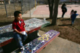 Seth Lopez (cq), 4, sits on a picnic bench covered with graffiti at the Ute Mountain Ute Tribe...