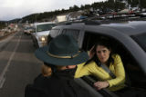 MJM196  Colorado State Patrol officer, Clare Faulkner (cq), left, advises Kate Montiero (cq),...