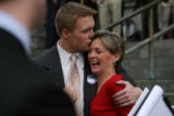 August Ritter III, cq, son of the Governor Bill Ritter, kiss his mother Jeannie Ritter, cq, as she...