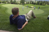 (Castle Rock, Colo., August 3, 2004) Brian Sehram, of Golden watches Davis Love III putt on the...