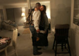 Maj. Steve Beck (cq) gives Joyce Cathey (cq) a hug good-bye as he leaves the Cathey's home in Reno...