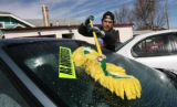 Harold Bode (cq) washes a car Tuesday afternoon, February 20, 2007, at Millennium used cars, 3701...