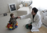 Caroline Cathey holds the hand of her grandson James J. Cathey Jr. (cq) on February 17, 2007,...