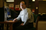 Vince Parry (cq), Corazon Parry's ex-husband does research at the Aurora Public Library after he...