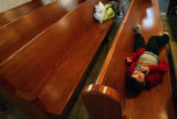 Carlos Lara (cq), 5, lies in ther pews at morning mass for Ash Wednesday at the Our Lady of...