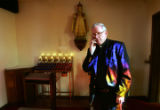 Father Robert Reycraft talks on the phone before he prepares ashes by burning palms from 2006 Palm...