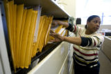 (DLM6435) -  Deputy Public Trustee Rhonda Stewart files through some foreclosures waiting to...