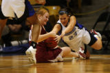 DLM0852  Berthoud's Brittany Fiske, left, and Broomfield's Caitlin Stem fight for a loose ball...
