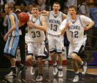 From left- Pierce Hornung,Tim Flageolle, and Tanner Jones, of Ralston Valley, celebrate winning...
