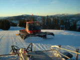 DSC01339 As the sun sets on Vail ski area, Aaron Mitchell pushes excess snow up Eagle's Nest Ridge...