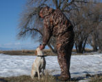 Libby enjoys a chin scratching from Steve Montague on a relaxed day of goose hunting. The season...