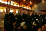Denver police chief Gerry Whitman, left, and Denver Fire Chief Larry Trujillo, front center, join...