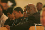Denver Police Officer Ambrose Slaughter, right, and his wife Virginia,  attend the funeral for...