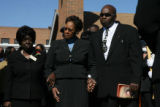 JM0937 -  (from left to right) Taylor Funeral Services employee, Eva Cowans accompanies Virginia...