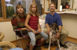(WESTMINSTER, Colo. August 18, 2004) Kacy, left, Breanna, 9, Makai, a German shorthair pointer,...