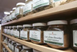A large supply of specific need ingredients are displayed on an expansive shelf display. The...