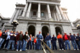 Steve Bingham (cq),center, speaks during a CDOT a rally at the west steps of the capital Friday...