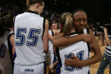 DLM0531  Broomfield's Chaundra Sewell breaks into tears as she hugs teammate Ashley Snow after...
