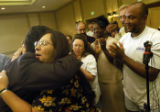 (DENVER, Colo., Aug. 16, 2004) Diana Crespin hugs United Food and Commercial Workers Local 7...