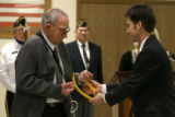 World War II veteran Ernest Peterson, cq,  receives military service medals he earned 62 years ago...