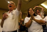 (DENVER, Colo., Aug. 16, 2004)  Marvin Wallingford (lt.) and Lulu Rael (rt.) cheer during a press...