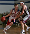 Silver State's #23, Joe Achenbach, left, drives on Community Christian's Jed Mahan, right,  in the...