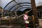 MJM559  Ailie Wood, 4, of Denver walks past the inclosure that held the jaguar that mauled a Zoo...