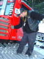 DSC01331 Shift supervisor Jim Lousberg checks the oil on a new PistenBully 300 snowcat at the...