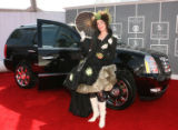 Music artist Imogene Heap strikes a pose next to a GRAMMY Edition Cadillac Escalade on the red...
