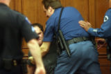 Nick Pappas (cq) is restrained by Arapahoe County Sheriff deputies after screaming at his mother...