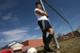 MJM007 Jovan Conchas (cq) leans against a pole as he waits to play soccer Sunday as the currently...