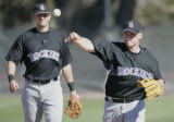 Colorado Rockies short-stop Clint Barmes, right, and Troy Tulowitzki, take turns fielding...