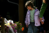 MJM473  Darien Rhoads, 3, holds the hand of the mother, Ari Rhoads (cq) as they walk past a...