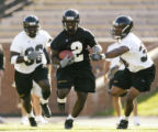 10 August, 2004 -- Missouri running back Damien Nash (2) runs the ball while being pursued by...