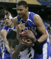 AXD108 - Mississippi State's Charles Rhodes (23) fights for the ball with Kentucky's Randolph...
